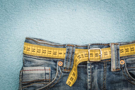 obesity: Jeans and measuring subject for weight loss