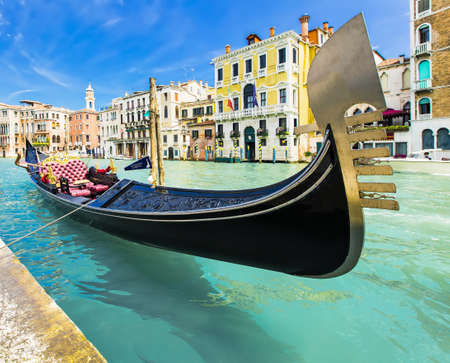 gondolier: Tourists travel on gondolas at canal Venice, Italy . Gondola trip is the most popular touristic activity in Venice.