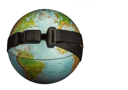 seat belt: Globe with a seat belt on a dark background