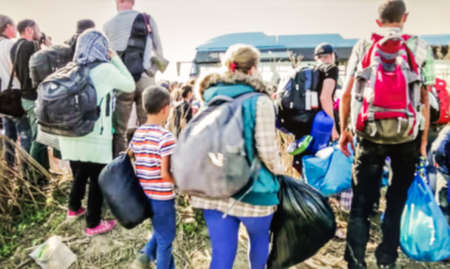 migrate: The refugees migrate to Europe. blurred, bokeh background, defocused