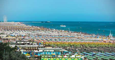 beachfront: RIMINI, ITALY - JUNE 24, 2014: Beachfront comfortable beaches of Rimini extends for 15 killometrov. Editorial