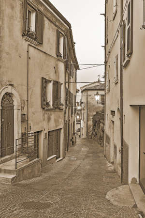 eventide: Evening small street Tuscany, Italy. Old style sepia.