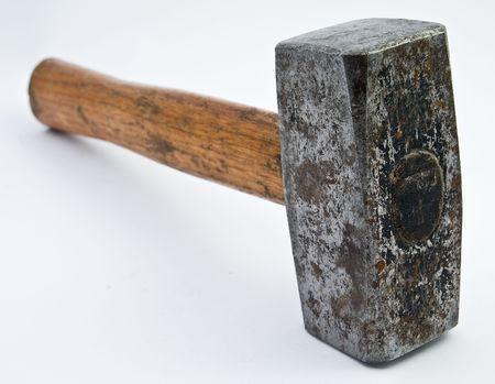 heavy hammer on white underground