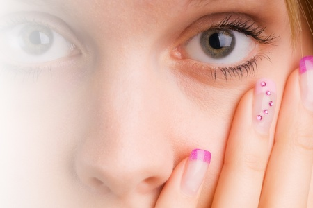 coloured pink female fingernails in the face with eye photo