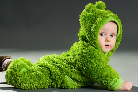 sweet cute baby dressed in a frog suit photo