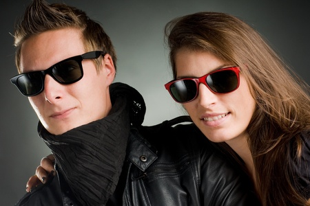 shades of grey: wild couple with sunglasses and leather jacket