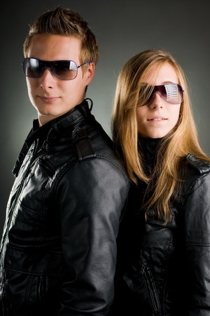 couple with leather jackets and sunglasses