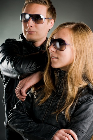 couple with leather jackets and sunglasses photo