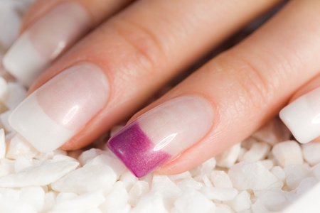 beautiful female colored fingernails in pink and white