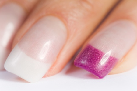 beautiful female colored fingernails in pink and white photo