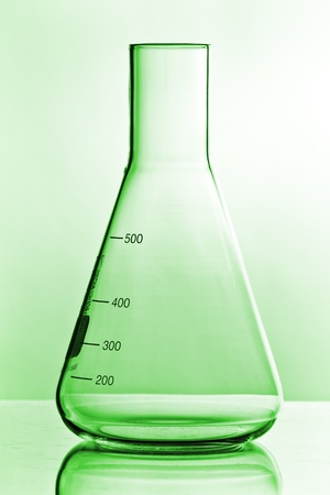 green chemistry glass on white ground with reflection photo
