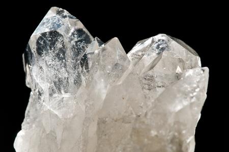 quarz: white shining rock mountain crystall quarz on black ground