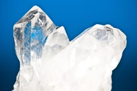 quartz: white shining rock mountain crystall quarz on blue ground
