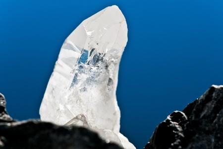 white shining rock mountain crystall quarz on blue ground Stock Photo - 10773902