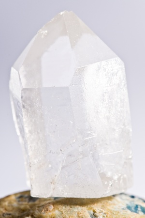 white shining rock mountain crystall quarz on white ground Stock Photo
