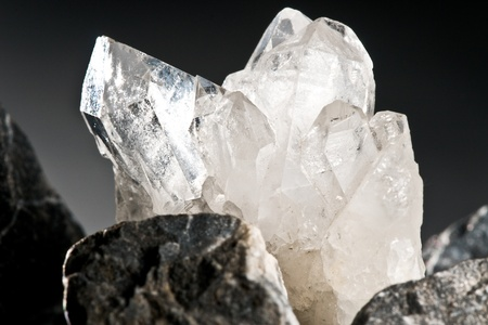 white shining rock mountain crystall quarz on black ground Stock Photo - 10773909