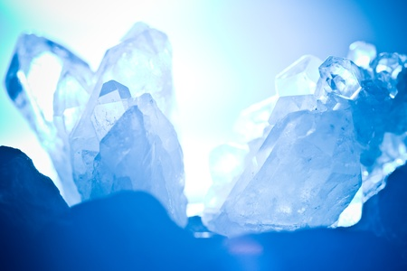 energy healing: white blue shining rock mountain crystall quarz Stock Photo