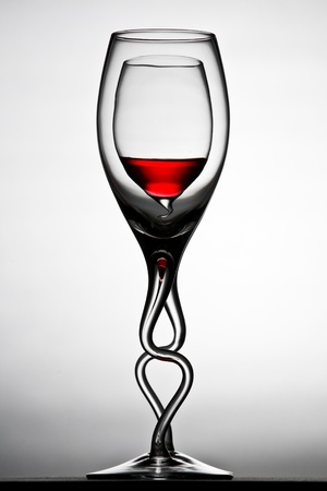 double glass: curved double red wine glasses with reflection