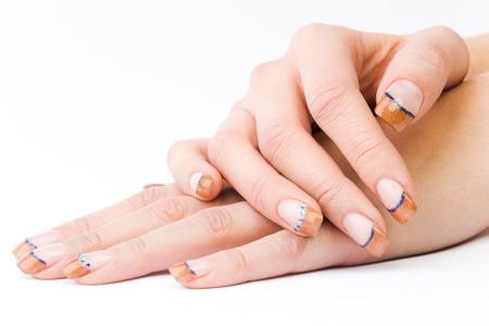 beautiful female colored fingernails isolated on white ground