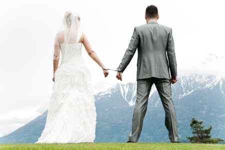 weddingrings: bride and groom bounded with handcuffs
