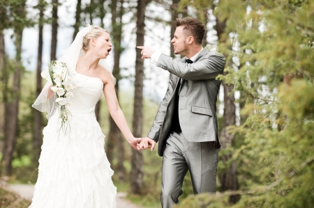 bride and groom quarreling in the wood