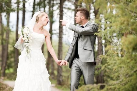 weddingrings: bride and groom quarreling in the wood