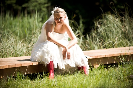 weddingrings: bride in the nature with red gumboots in the nature Stock Photo