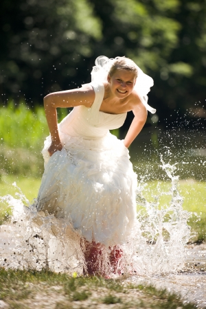 bride in the water with red gumboots