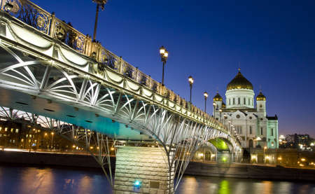 Moscow, the biggest cathedral of the city - cathedral of jesus Christ Saviour and bridge on bank of Moscow-river at night.