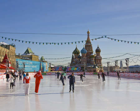 Moscow, skating-rink on Red square with St. Basils (Pokrovskiy) cathedral.  Moscow, skating ring on Red square with St. Basils (Pokrovskiy) cathedral.   In winter Red square changes in a big skating-rink, remaining from December till April, - this is a