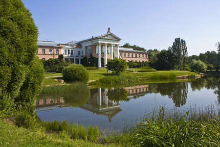 classicism: Moscow, administrative building of Botanic gardens in classicism style near pond.