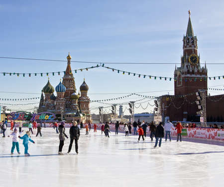 Moscow, Russia - March 08, 2010: skating-rink on Red square, St. Basils (Pokrovskiy, Intercession) cathedral and Spasskaya Kremlin tower.  Moscow, Red square with St. Basils (Pokrovskiy) cathedral and Spasskaya Kremlin tower. In winter Red square change
