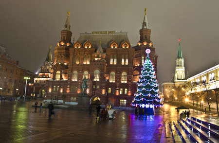 Moscow, Russia - December 14, 2011: Christmas tree on Manezhnaya square, Kremlin tower and Historical museum around.