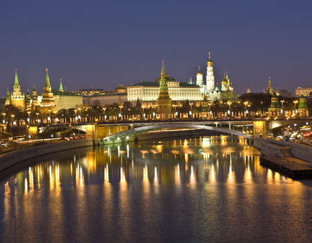 Moscow, Kremlin fortress with palace and cathedrals and Big Stone bridge on Moscow-river at night.