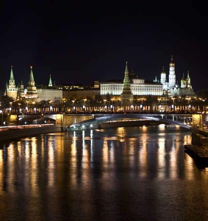 Moscow, Kremlin fortress with palace and cathedrals inside on bank of Moscow-river at night. photo