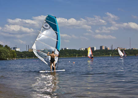 windsurfers: Moscow, Russia - June 27, 2010: Windsurfers in Strogino on Moscow-river.