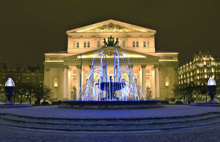 Moscow, Russia - December 21, 2011: Big (Bolshoy) theatre and electric winter fountain on Theatre square at night.