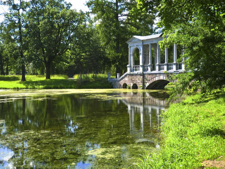 Bridge in park in Tsarskoye selo, surroundings of St. Petersburg, Russia. photo
