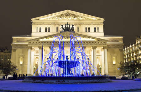 Moscow, Russia - December 21, 2011  Big  Bolshoy  opera and ballet theater and electric winter fountain on Theatre square at night  Редакционное