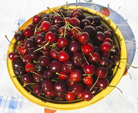 topdown: Plate with many red cherries, view top-down  Stock Photo
