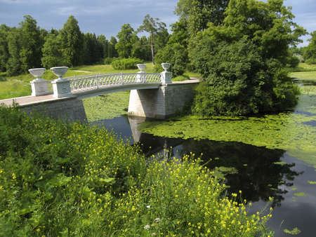 Summer landscape - white bridge on river, recorded in park in Pavlovsk, surroundings of St  Petersburg, Russia Stock Photo - 12822294