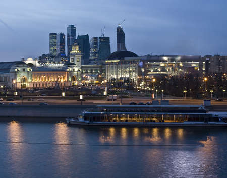 Moscow, Kievskiy railway station on bank of Moscow-river and business centre Moscow-city at night. Stock Photo - 12903653
