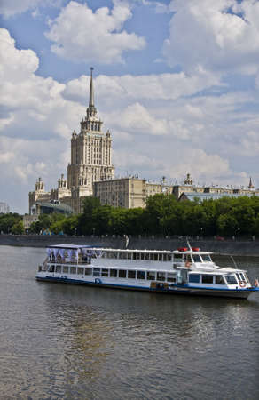 Moscow, Russia - May 23, 2010: Moscow-river and hotel Ukraine (new name Radison Royal) and cruise boat.Recorded 23.05.2010.