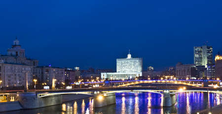 Moscow, Borodinskiy bridge and White house (House of Russian Government) at night.