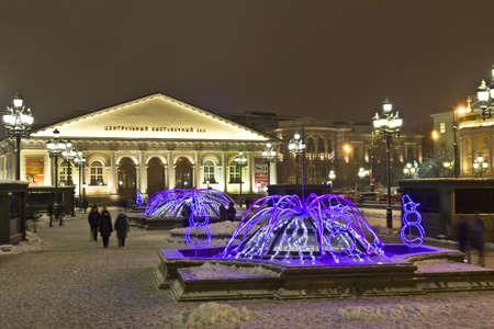 Moscow, Russia - January 09, 2012: electric winter fountains on Manezhnaya square and exhibition hall
