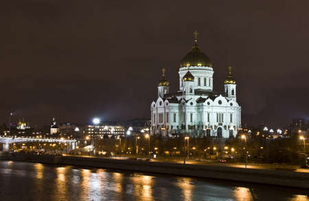Moscow, Russia - November 24, 2011: cathedral of Jesus Christ Saviour at night on bank of Moscow-river. photo