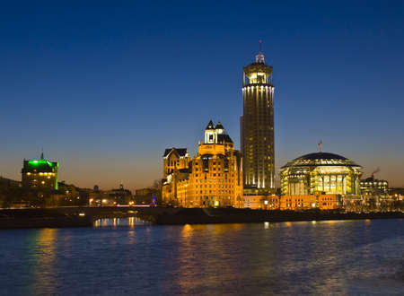 Moscow, Russia - April 06, 2012: business centre on Shluzovaya quay at night on bank of Moscow-river (consist concert hall International House of Music, Swiss hotel and business centre building). Stock Photo - 13096136