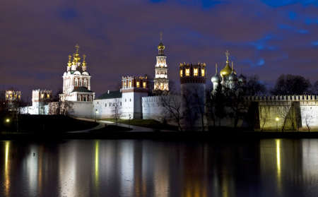 Moscow, Russia - December 06, 2011  Novodevichiy monastery on bank of pond at night  photo