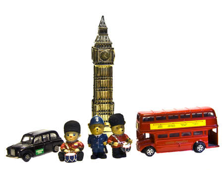 English souvenirs, symbols of London - toys Big Ben tower, red bus and black taxi, policeman and solgers, isolated on white background. photo