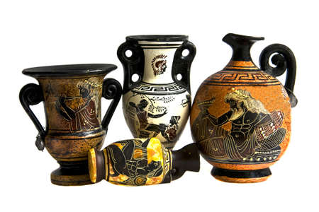 Souvenir immitation of antique (ancient) Greek amphoras, isolated on white background. photo